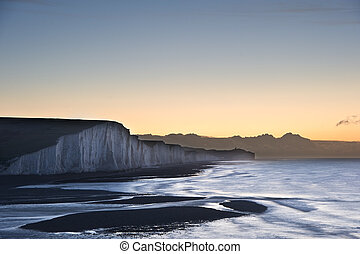 Seven Sisters chalk cliffs in England during Winter sunrise