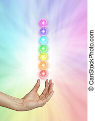 Seven Spinning Chakras - Female healing hand outstretched ...