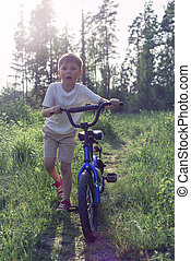 seven-year-old boy riding a bike in the Park