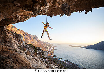 Seven-year old girl climber hanging on rope - Seven-year old...