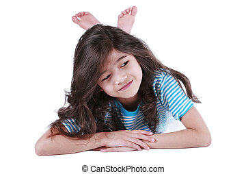 Seven year old girl lying down on floor, smiling