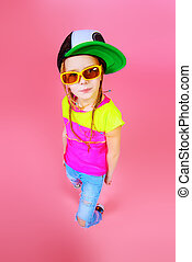seven year old girl - Trendy little girl in a cap smiling to...