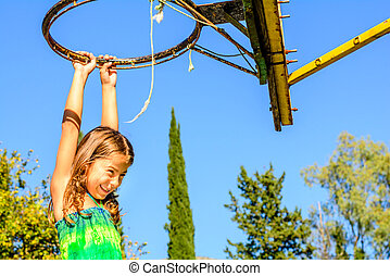 Seven year old girls playing basket - seven year old girl is...
