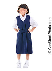 Seven years old Southeast Asian school girl in school uniform, fullbody over white background