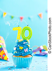 Seventieth 70th birthday cupcake with candle blow out.Card...