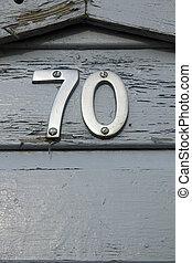 Seventy - Metal number 70 on grey-blue painted front door
