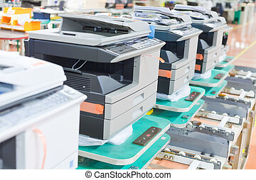 several assembled copiers on factory close up