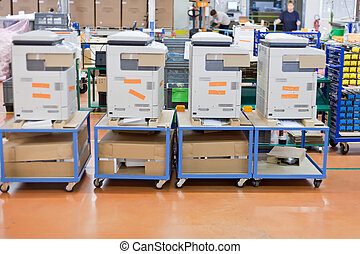 several assembled copiers on factory - several assembled...