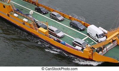 automobiles and passengers on deck of ferry boat float in sea