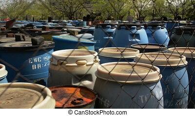 Several barrels of toxic waste glider footage - Several...