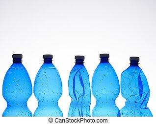 several blue crushed plastic bottles