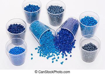 several blue plastic granulates