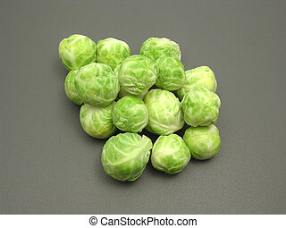 Several Brussels sprouts on a dull matting