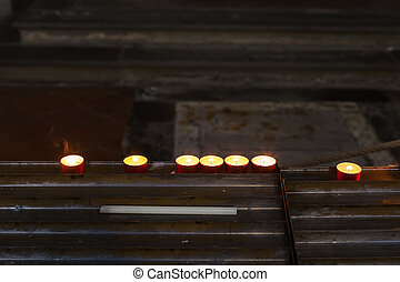 burning commemoration candles in church