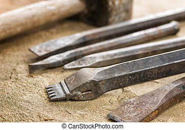 Several chisels with a mallet