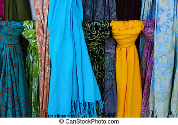 Several colorful scarves in the streets of Barcelona, Spain