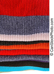 Several colors pullovers stack - Background of several ...
