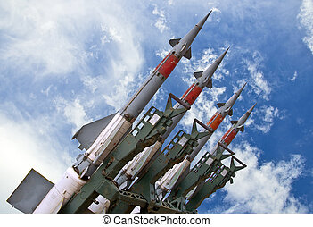 Several combat missiles aimed at the blue sky. Missile weapons.