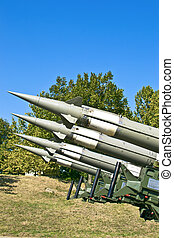Several combat missiles aimed at the sky