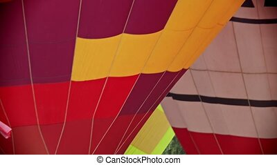 Several different air balloons are ready to take off. Mid...