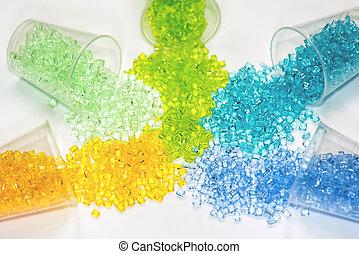 several dyed transparent polymer granulates - polymer resins...