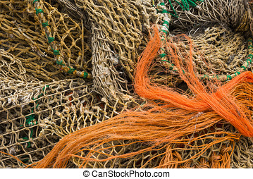 Several Fishing Nets in orange and brown.