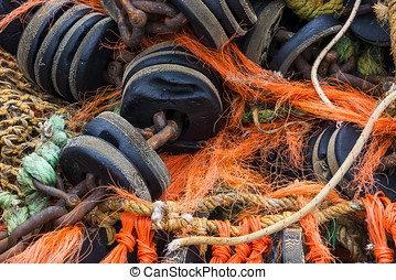 Several fishing nets - Several orange and brown fishing...