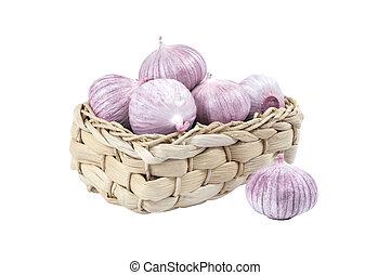 Several garlic in a wicker basket