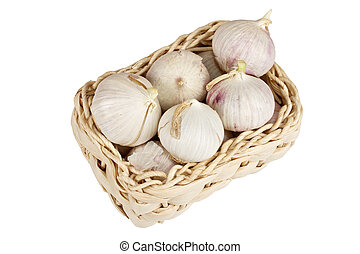 Several garlic onions in a basket isolated