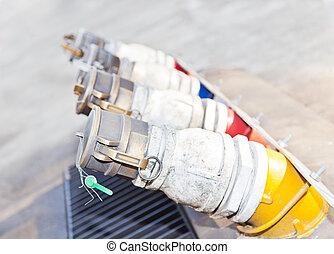 Several gasoline pump nozzles at petrol station for transportation