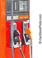 Several gasoline pump nozzles at petrol station