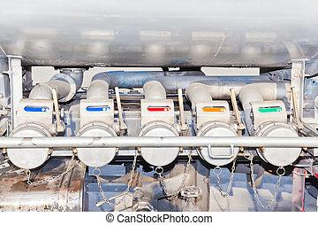 Several gasoline pump nozzles for transportation