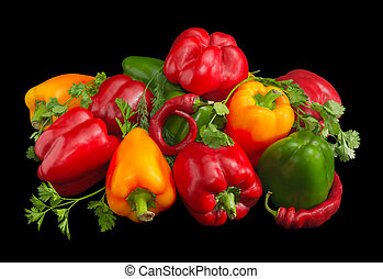 Several green, yellow and red bell peppers, chili and greens