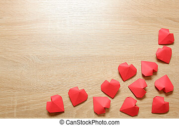 Several handmade 3D red paper hearts on light oak wood background copy space. Love, Valentine's, mother's, women's day, relations, wedding, romantic template copy space. Love, Valentine's day,concept