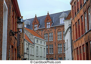Several historical red houses in Bruges, Belgium