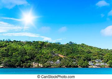 Several hotels on green shore of La Digue island, Seychelles...