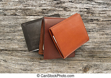 Several leather wallet - leather wallet with money, some...