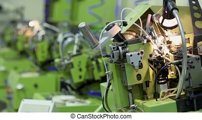 Several machines for manufacturing chains are in row at...