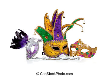 Several mardi gras masks on white with copy space - Several...