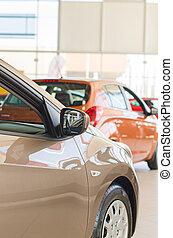 Several new cars at dealership salon.