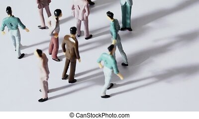 Several painted toy men stand and drop shadows