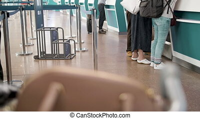 Several passengers standing in queue while waiting for check...