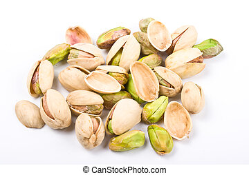 Several pistachio nuts naked and in shell close up isolated