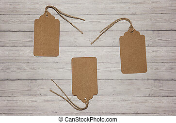 Several price tags on a wooden background, the concept of sales
