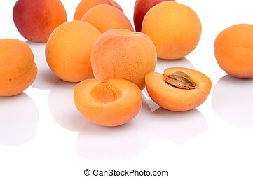 Several sliced apricots isolated on white