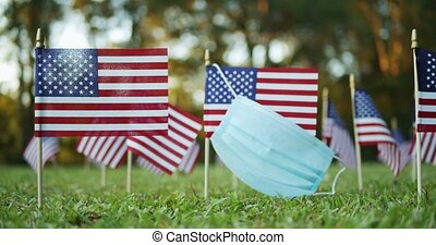 Several small American, US or USA, flags with worn surgical ...