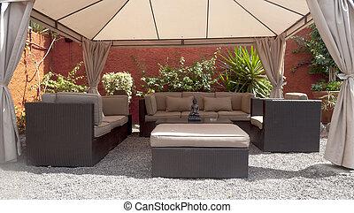 Several sofas on a patio zen