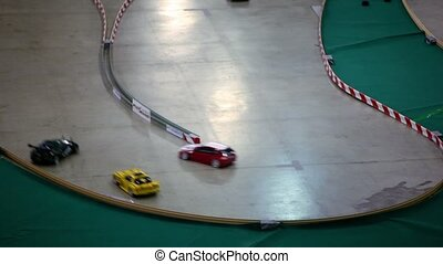 Several toy car with remote control ride on track turn