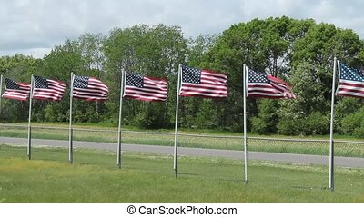 United States flags - several United States flags blowing in...