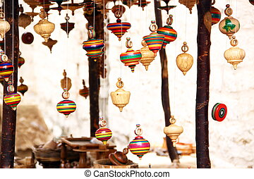 Several wooden spinning tops - Several colorful wooden...